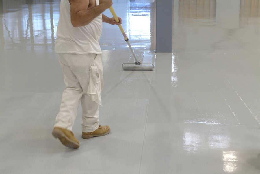 This is a picture of a man cleaning the floor.